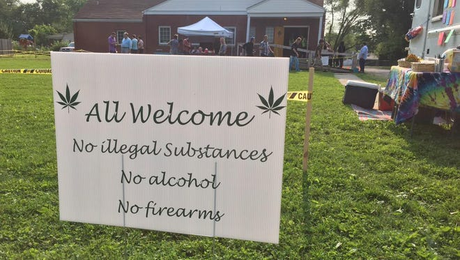 A sign posted outside the First Church of Cannabis welcomes guests.