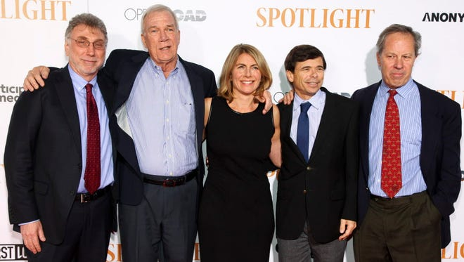'The Boston Globe' team, from left, Marty Baron, Walter Robinson, Sacha Pfeiffer, Michael Rezendes and Ben Bradlee Jr.