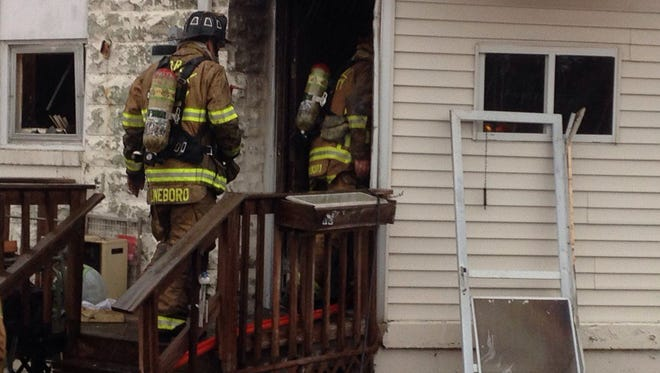 Firefighters work on the scene of a fire in Codorus Township.