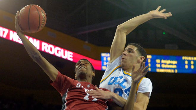 UCLA guard Lonzo Ball (2) defends Stanford guard Marcus Sheffield (14) during the first half.