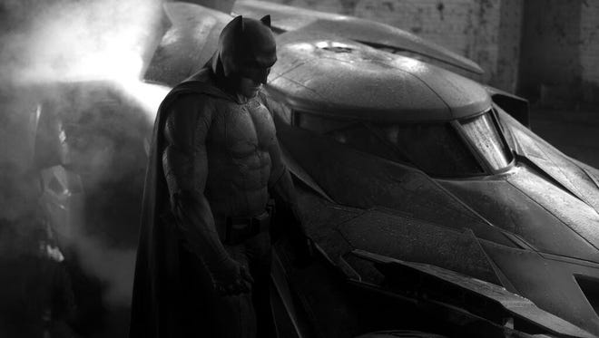 "In early July, director Zack Snyder tweeted out the first peek of Ben Affleck looking buff in his Dark Knight armor, cape and cowl from the set of ""Batman v. Superman: Dawn of Justice."""