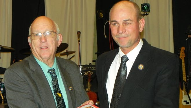 Bill Sauble of Sauble Ranch in Maxwell, at left, presented the 2015 New Mexico Cattle Growers Association's Inspector of the Year Award to Buddy Eby of Silver City.