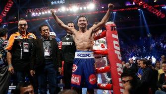 Manny Pacquiao celebrates after defeating Chris Algieri.