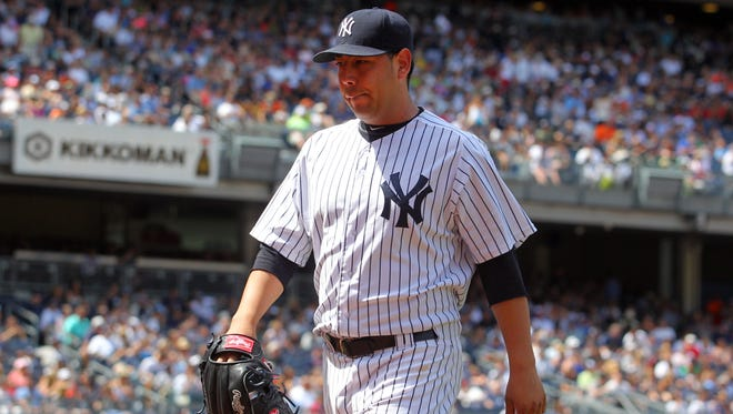 Yankees starting pitcher Vidal Nuno is taken out of the game against the Baltimore Orioles during the seventh inning at Yankee Stadium on Saturday.