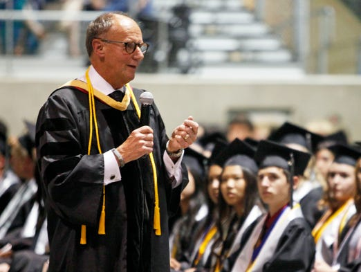 Retiring principal Ed John comes down to student level to talk to them at the West Salem High School graduation at The Pavilion Thursday June 5, 2014.