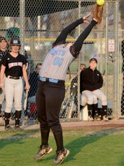 South Gibson's Taylor Benton makes a leaping catch Thursday against South Side.