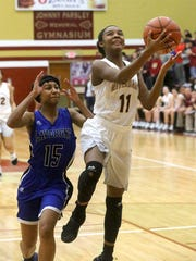 Riverdale's Alasia Hayes (11) goes up for a shot as