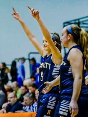 Karson Tripp of Haslett celebrates the Vikings' win over Ionia in their Class A regional semifinal game Tuesday March 10, 2015 in Charlotte. KEVIN W. FOWLER PHOTO