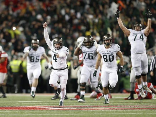 MSU kicker Michael Geiger (4) runs down the field as teammates, including Jack Conklin (74), celebrate after Geiger kicked the game-winning 41-yard field goal as time expired against Ohio State.