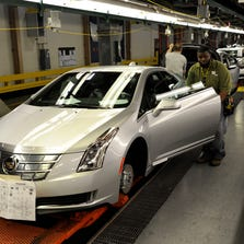 Ken Greene checks the fit on the door on a 2014 Cadillac ELR at GM's Detroit-Hamtramck Assembly Plant earlier this year. Production has been halted for retooling since August to prepare for new <137>Cadillac and other new <137>vehicles.<252><137>Photo of Ken Greene(cq), door fitter, with the 2014 Cadillac ELR at GM's Detroit-Hamtramck Assembly plant line in Detroit on Friday 1.24.14. (David Coates/The Detroit News)<252><137>