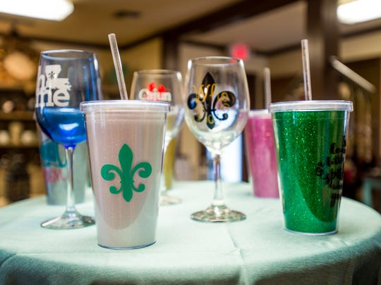 An assortment of Louisiana-themed drinking cups  on display at Cajun Belle in Lafayette.
