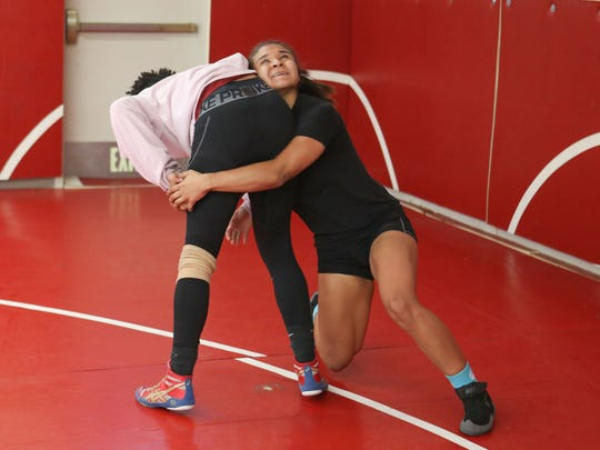 Palm Springs high school wrestler Cindy Zepeda practices takedowns with a teammate during wrestling practice, February 21, 2018.