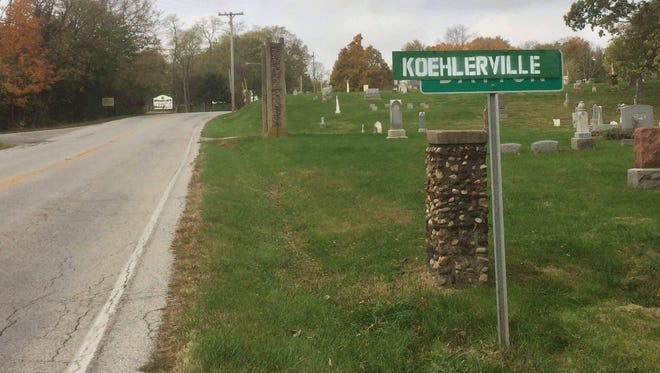 "The Dayton town marker is covered by a makeshift sign reading, ""Koehlerville,"" at the east entrance to the town along Indiana 38, near the Dayton Cemetery. The signs were an apparent prank on Oct. 31, 2017, meant to troll Ron Koehler, a town council member, and his wife, Cindy Marsh, who have been outspoken in opposition to an annexation plan and subdivision expected to follow."