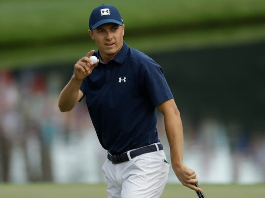 Jordan Spieth reacts after his putt on the 16th hole