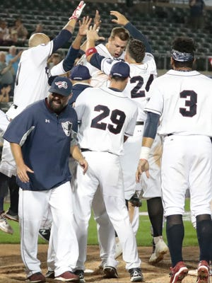 Scott Kelly celebrates with his Somerset Patriots teammates after hitting a walk-off home run in Game 1 of the Liberty Division playoffs.