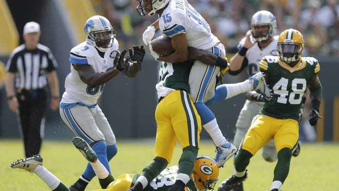 Packers defensive back Kentrell Brice stuffs Detroit Lions receiver Golden Tate during their game Sunday, Sept. 25, 2016 at Lambeau Field.