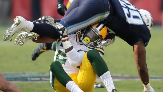 Green Bay Packers cornerback Quinten Rollins (24) brings down Tennessee Titans running back DeMarco Murray (29) at Nissan Stadium in Nashville, Tenn.