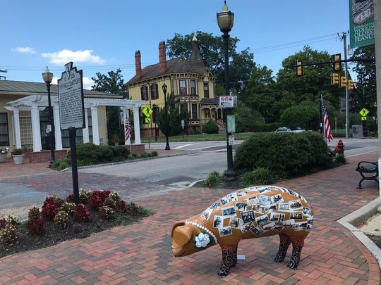 "A decorative Smithfield pig. ""Country meats are what brought this area to the fore in the 1800s,"" said a former Smithfield Foods executive."