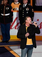Trace Adkins performs the National Anthem before the