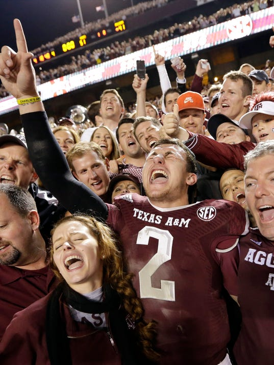 FILE - In this Nov. 9, 2013, file photo, Texas A&M quarterback Johnny Manziel (2) celebrates with fans after an NCAA college football game against Mississippi State in College Station, Texas. Manziel could be the answer to Cleveland's prayers at quarterback. The polarizing and popular Texas A&M star will likely be available when the Browns pick fourth in next week's NFL draft. (AP Photo/David J. Phillip, File)