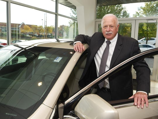 Michael Mullaney, president of Hudson Cadillac Buick GMC, stands in the showroom of his dealership on Route 9 in the Town of Poughkeepsie.