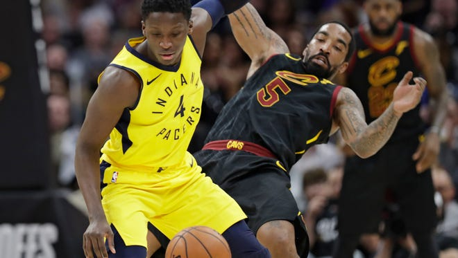 Indiana Pacers' Victor Oladipo (4) drives against Cleveland Cavaliers' JR Smith (5) during the first half of Game 2 of an NBA basketball first-round playoff series Wednesday, April 18, 2018, in Cleveland.