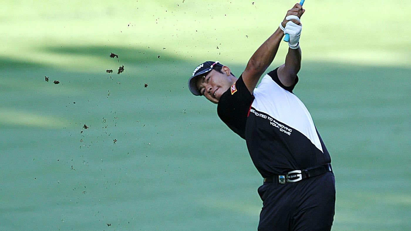 Hideki Matsuyama hits from the fairway on 13.