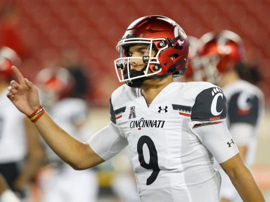 Cincinnati quarterback Desmond Ridder has been dealing with a shoulder injury, and it's unclear if he'll get the start against Memphis in the AAC title game Saturday.