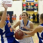 Trista Magee (center) drives between Columbia Academy defenders Dianna Hobgood (left) and Miranda Magee on Friday, February 27, 2015, at the MAIS Overall Basketball Tournament in the A.E. Wood Coliseum on the Mississippi College campus in Clinton.