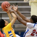 Quitman's Thurston McCarty (left) fights for a rebound with Byhalia's Almalik Steele on Friday, March 6, 2015, in the MHSAA state basketball tournament at the Lee E. Williams Athletics & Assembly Center on the Jackson State University campus in Jackson, Miss.