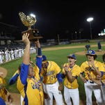 The Oxford Chargers celebrate with the Class 5A trophy after beating George County, 9-0, in Game 2 on Thursday in the MHSAA State Championship at Trustmark Park in Pearl.
