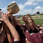 The East Webster Wolverines celebrate with the Class 2A trophy after beating Taylorsville, 12-2, in Game 3 on Saturday, the final day of the 2015 MHSAA Baseball State Championships at Trustmark Park.