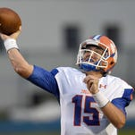 Madison Central quarterback Jack Walker throws deep for a touchdown against Meridian on Friday, August 21, 2015, at Meridian High School in Meridian, Miss.