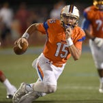 Madison Central quarterback Jack Walker keeps the ball for a first down against Brandon on Saturday.
