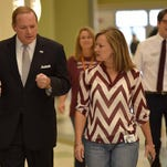 Mississippi State University President Mark E. Keenum,left, escorted by senior counselor Shannon Cox, second from right, arrives to speak to students at Germantown High School in Gluckstadt, on Wednesday morning, September 2, 2015. Keenum spoke to Madison Central students after leaving Germantown.