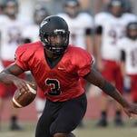 Clinton quarterback Cam Akers scrambles away from the Brandon pass rush on Friday at Clinton High School.