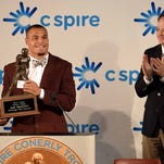 Mississippi State quarterback Dak Prescott hoists the trophy for the second consecutive year at the 20th Annual C Spire Conerly Trophy presentation on Tuesday, December 1, 2015, at the Mississippi Sports Hall of Fame & Museum in Jackson, Miss.
