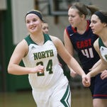 Kaylee Anthes (24) of Oshkosh North breaks into a smile after putting up a shot playing against Appleton East Thursday, Feb. 4, 2016.