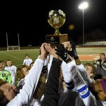 The Stone Tomcats celebrate with the trophy after beating Germantown 2-1 in the second 10-minute overtime period on Saturday, February 6, 2016, at the MHSAA Soccer Championships at Madison Central High School in Madison, Miss.