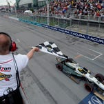Mike Conway takes the checkered flag to win the second race of the day at the Toronto IndyCar doubleheader Sunday in Toronto.