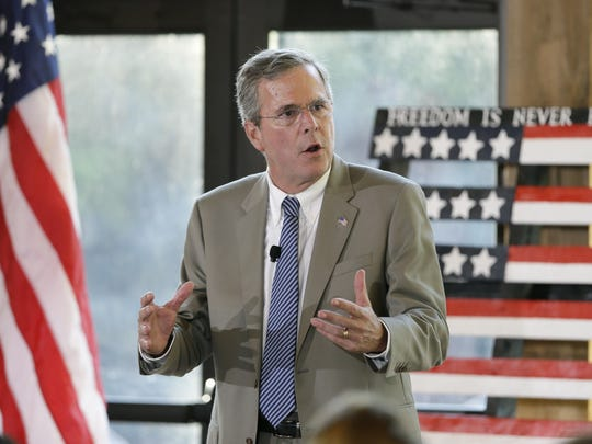 Republican presidential candidate former Florida Gov. Jeb Bush speaks to local residents during the Judge Joseph Story Dinner, Monday, July 13, 2015, in Ames, Iowa. (AP Photo/Charlie Neibergall)