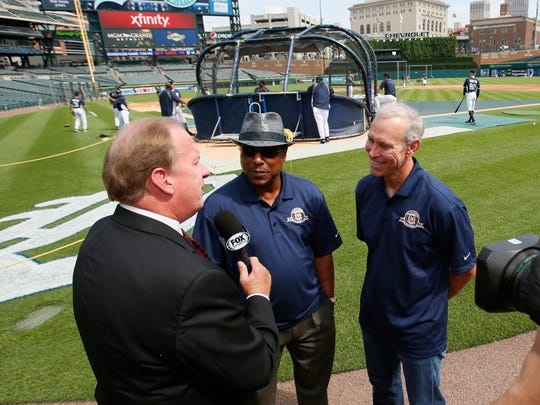 Fox Detroit's John Keating interviews 1984 Detroit Tigers team members Lou Whitaker, left, and Alan Trammell on the field before the Detroit Tigers baseball game against the Oakland Athletics in Detroit on Monday, June 30, 2014.