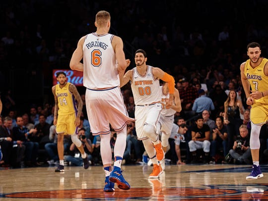 New York Knicks' Enes Kanter (00), celebrates with