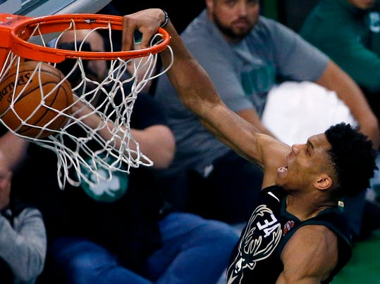 Milwaukee Bucks' Giannis Antetokounmpo dunks during overtime in Game 1 of an NBA basketball first-round playoff series against the Boston Celtics, in Boston, Sunday, April 15, 2018. The Celtics won 113-107. (AP Photo/Michael Dwyer)