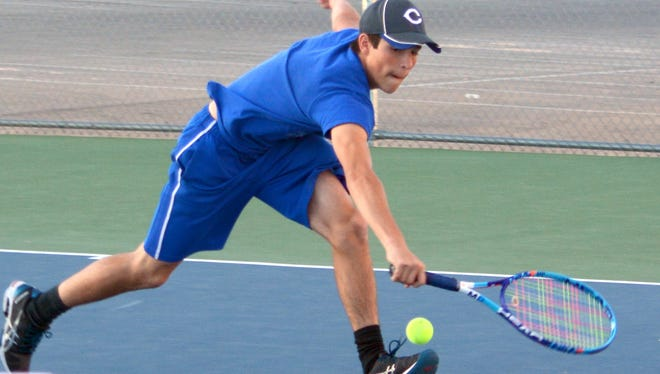 Cavemen freshman Max Garcia tries to keep the ball moving during Monday's practice. Carlsbad will host the Carlsbad Invitational on Friday and Saturday.