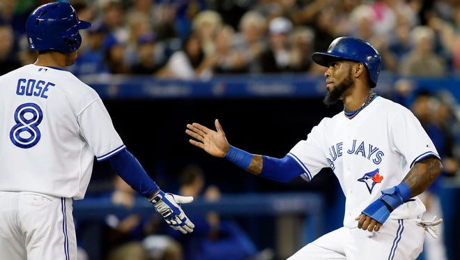 Anthony Gose (8) and Jose Reyes (7) celebrate in the fourth inning.