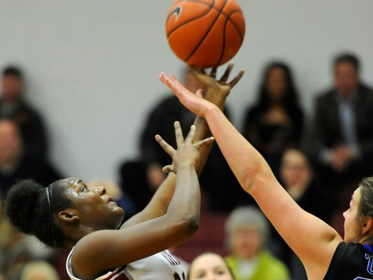 Ezell Harding's Brittany Miller (32) shoots over BGA's Allison Cowie (30) during the first half of the girls DII-A Region tournament Tuesday Feb. 10, 2015, in Nashville, Tenn.
