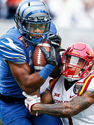 Memphis running back Tony Pollard (left) grabs a first down catch in front of Iowa State defender D'Andre Payne (right) during first quarter action of the AutoZone Liberty Bowl in Memphis, Tenn., Saturday, December 30, 2017.