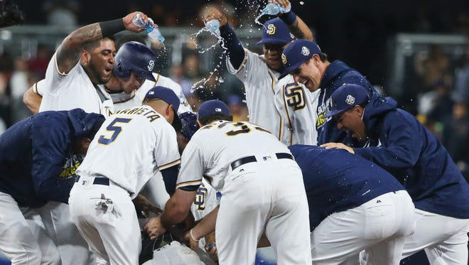 The San Diego Padres celebrate after Wil Myers drove in the winning run against the Atlanta Braves in the ninth inning on June 7, 2016.