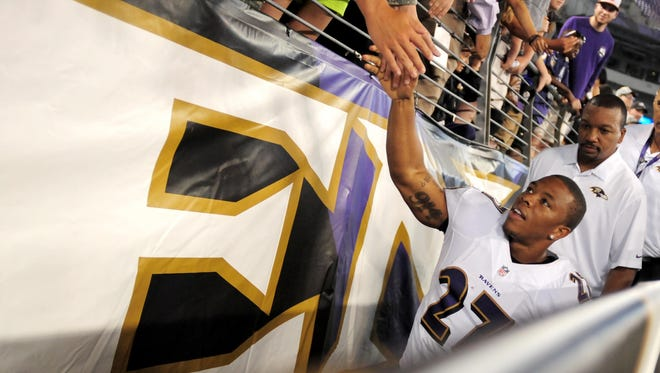 Baltimore Ravens running back Ray Rice (27) high fives fans after beating the San Francisco 49ers 23-3 at M&T Bank Stadium.